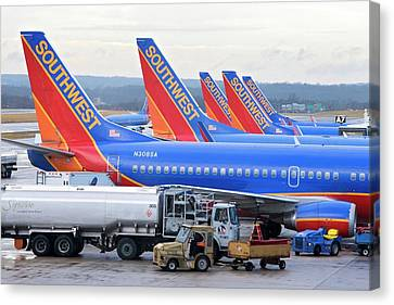 Passenger Jet Airliners At Airport Canvas Print by Jim West