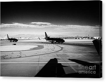 passenger jets waiting in line to take off at McCarran International airport Las Vegas Nevada USA Canvas Print