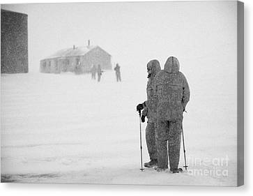 Passengers From Expedition Ship On Shore Excursion To Whaler's Bay Antarctica Canvas Print by Joe Fox