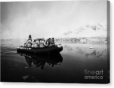 Passengers On Board A Zodiac In Fournier Bay On Excursion In Antarctica Canvas Print by Joe Fox