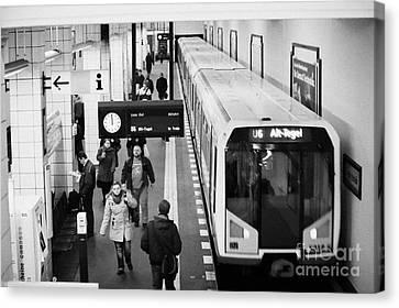 Ubahn Canvas Print - passengers on ubahn train platform as train leaves Friedrichstrasse u-bahn station Berlin Germany by Joe Fox
