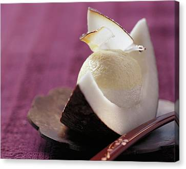 Passion Fruit And Coconut Cream In A Wedge Of Coconut Canvas Print