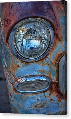 Patinaed Headlight Canvas Print by Peter Tellone