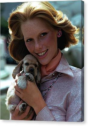 Spaniel Puppy Canvas Print - Patti Hansen Carrying A Puppy by William Connors