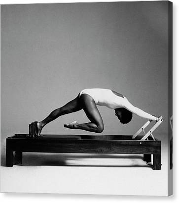 Fitness Instructor Canvas Print - Paula Kelly Exercising On The 'reformer' Machine by Francesco Scavullo