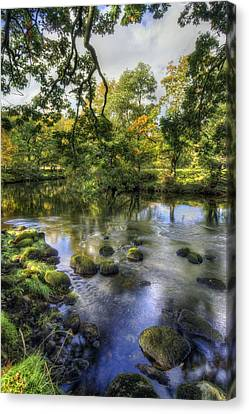 Peaceful River Canvas Print by Ian Mitchell