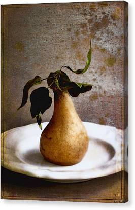 Pear On A White Plate Canvas Print