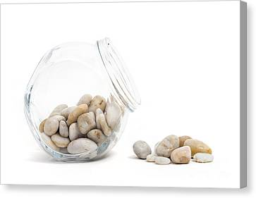 Pebbles And Glass Jar Against White Background Canvas Print
