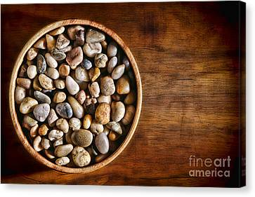 Pebbles In Wood Bowl Canvas Print by Olivier Le Queinec