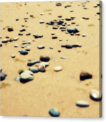 Pebbles On The Beach Canvas Print by Michelle Calkins