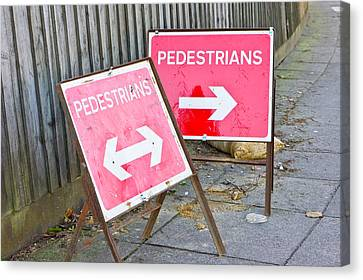 Pedestrian Signs Canvas Print by Tom Gowanlock