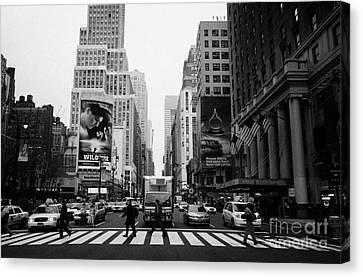 Pedestrians Crossing Cross Walk Between Pennsylvania Hotel And Penn Station On 7th Avenue New York Canvas Print by Joe Fox