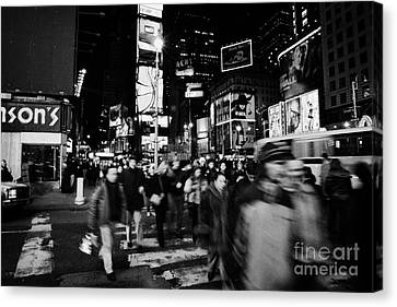 Pedestrians Crossing Crosswalk In Times Square At Night New York City Canvas Print by Joe Fox
