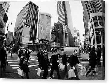 Pedestrians Crossing Crosswalk On 7th Ave And 34th Street Outside Macys New York City Usa Canvas Print by Joe Fox