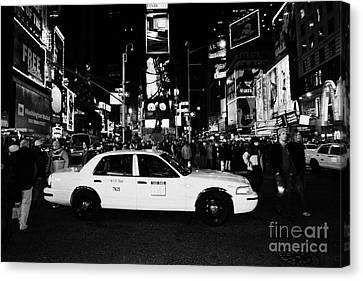 Manhatan Canvas Print - Pedestrians Walk Past Yellow Cab Stationary In The Middle Of Times Square At Night New York City by Joe Fox