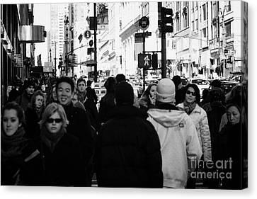 Pedestrians Walk Up A Busy Sidewalk In A Street On Fifth Avenue New York City Manhattan Canvas Print by Joe Fox