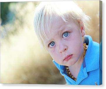 Pensive Boy Looking Towards Camera Canvas Print