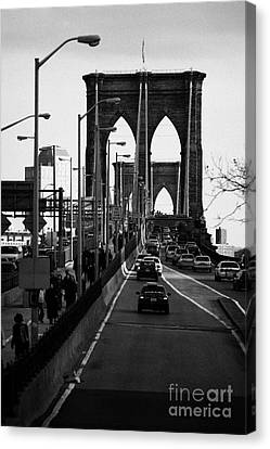 people and traffic crossing the Brooklyn bridge in the evening new york city Canvas Print by Joe Fox