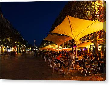 People At Sidewalk Cafes In A City Canvas Print by Panoramic Images