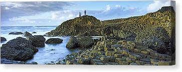 People Climbing On Rocks At Giants Canvas Print by Panoramic Images