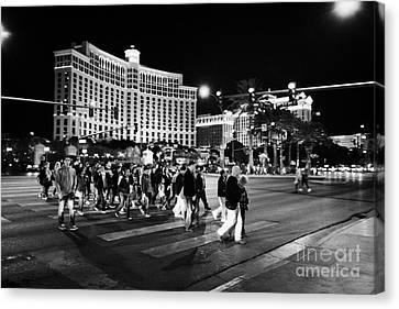 People Crossing Las Vegas Boulevard Outside The Bellagio At Night Nevada Usa Canvas Print by Joe Fox