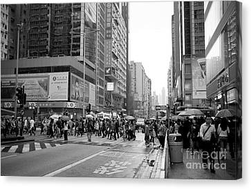 People Crossing The Street On A Rainy Day In Mong Kok Hong Kong Canvas Print by Ivy Ho