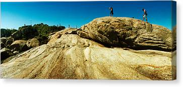 People Hiking Along The Boulders That Canvas Print