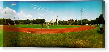 People Jogging In A Public Park Canvas Print
