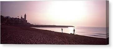 People Jogging On Beach, Sitges Canvas Print by Panoramic Images