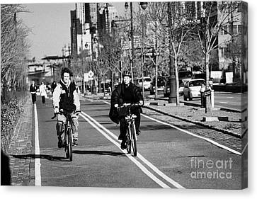 people mountain bikes exercising on bikeway next to West Side Highway new york Canvas Print by Joe Fox