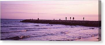 People On A Jetty In The Sea, Sitges Canvas Print by Panoramic Images