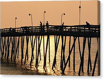 People On A Pier Are Silhouetted Canvas Print by Steve Winter