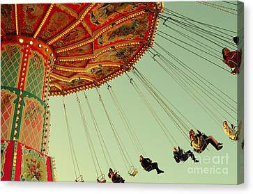 People On A Vintage Carousel At The Octoberfest In Munich Canvas Print by Sabine Jacobs