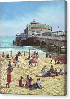 people on Bournemouth beach Pier theatre Canvas Print