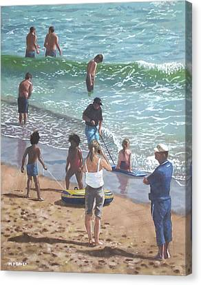 people on Bournemouth beach pulling dingys Canvas Print