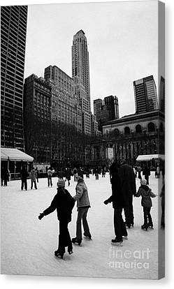 Manhatten Canvas Print - people skating on the ice at Bryant Park ice skating rink new york city by Joe Fox