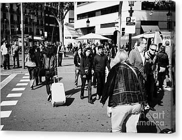 People Walking Across Busy Pedestrian Crossing Placa De Catalunya Barcelona Catalonia Spain Canvas Print by Joe Fox