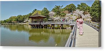 People Walking On Bridge Over A Pond Canvas Print by Panoramic Images