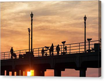 People Walking On Pier Canvas Print by Roberto Lopez