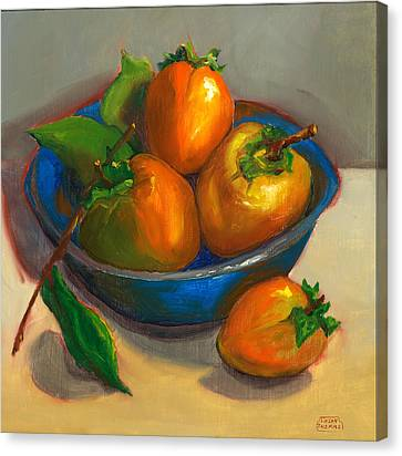 Persimmons In Blue Bowl Canvas Print by Susan Thomas