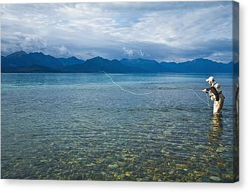 Person Flyfishing In Lake Clark Of Lake Canvas Print by Michael DeYoung