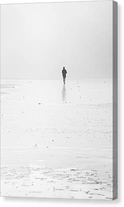 Person Running On Beach Canvas Print by Mikel Martinez de Osaba