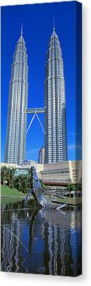 Petronas Towers Kuala Lumpur Malaysia Canvas Print by Panoramic Images