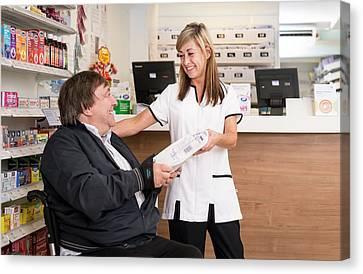 Pharmacist Dispensing Medication Canvas Print