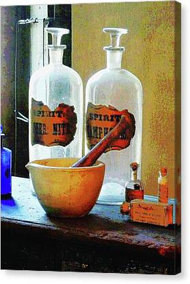 Pharmacist - Mortar And Pestle With Bottles Canvas Print by Susan Savad
