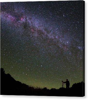 Photographer And The Milky Way Canvas Print by Babak Tafreshi