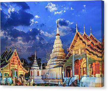Phra Singh Temple Twilight Time Viharn Lai Kam Wat Phra Singh Canvas Print by Anek Suwannaphoom
