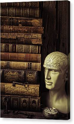 Phrenology Head And Old Books Canvas Print by Garry Gay