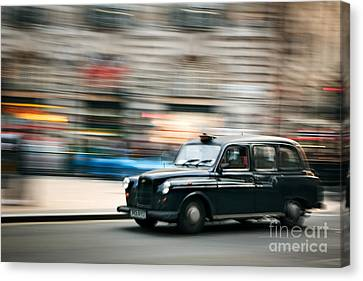 Piccadilly Taxi Canvas Print by Rod McLean