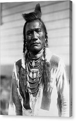 Piegan Indian Man Circa 1909 Canvas Print by Aged Pixel